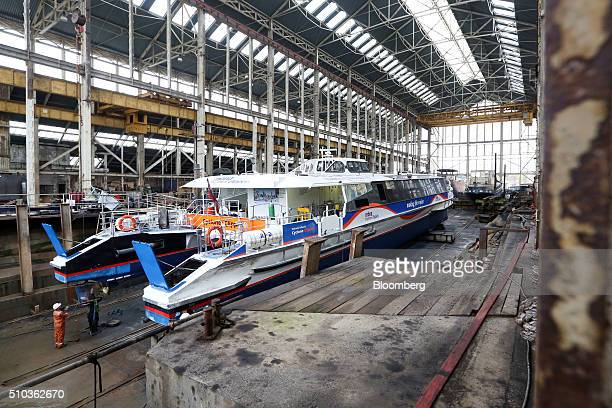 A Thames Clipper catamaran is worked on as it sits in a dry dock at Turks boatyard in Chatham UK on Thursday Oct 29 2015 The Thames Clipper river bus...