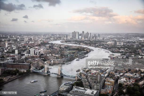 thames river stretching through the center of london, uk - art stock pictures, royalty-free photos & images