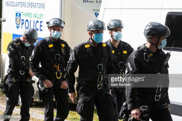 Thames Valley Police officers with face coverings and climbing gear prepare to arrest two anti-HS2 activists who had blocked a HGV used for works...