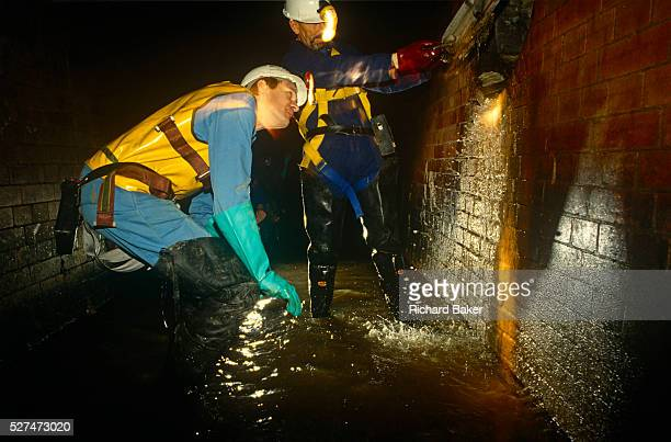 Thames Water Utilities sewer cleaning team inspects the Fleet River's Victorianbuilt storm sewer of Blackfriars beneath the streets of the City of...