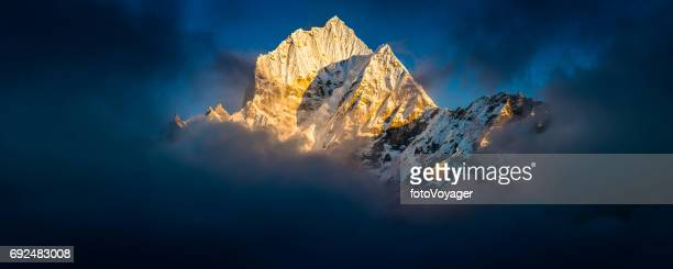 Thamserku 6623m Himalaya mountain peak panorama illuminated at sunset Nepal