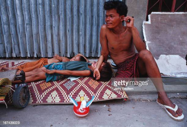Than Neoun lives with his wife and daughter at Wat Ounalom Than Neoun lost his leg to a mine while fighting for the Cambodian army was discharged...