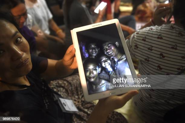 Thanaporn Promthep mother of one of the 12 missing boys displays an image believed to have been taken in 2017 of her son Duangpetch Promthep...