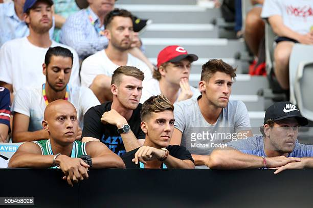 Thanasi Kokkinakis and Christos Kyrgios watch the first round match between Pablo Carreno Busta of Spain and Nick Kyrgios of Australia during day one...
