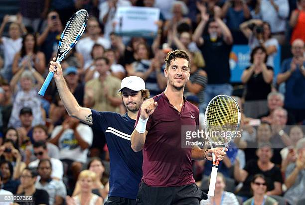 Thanasi Kokkinakis and Jordan Thompson of Australia celebrate victory against Gilles Muller of Luxembourg Sam Querrey of the USA after the Men's...