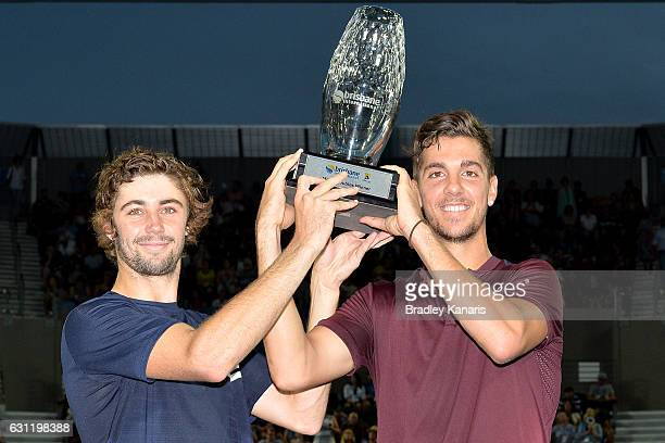 Thanasi Kokkinakis and Jordan Thompson of Australia hold up the winners trophy after their victory against Gilles Muller of Luxembourg and Sam...