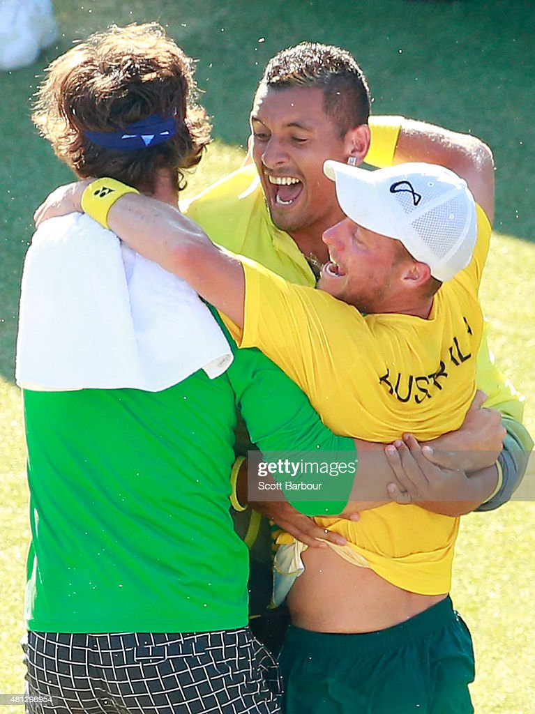 Thanasi Kokkinakis and Nick Kyrgios run on court to congratulate teammate Lleyton Hewitt of Australia as he celebrates winning the reverse singles match between Lleyton Hewitt of Australia and Aleksandr Nedovyesov of Kazakhstan during day three of the Davis Cup World Group quarterfinal tie between Australia and Kazakhstan at Marrara Sporting Complex on July 19, 2015 in Darwin, Australia.