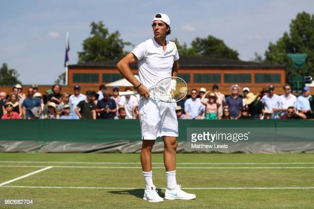 Thanasi Kokkinakis looks on against Fabrice Martin of France and Raluca Olaru of Romania during their Mix Doubles first round match on day five of...