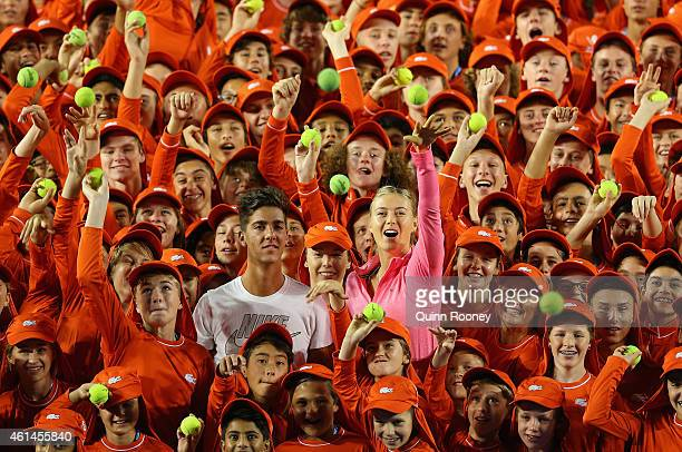 Thanasi Kokkinakis of Australia and Maria Sharapova of Russia pose for a photo with the ball kids of the Australian Open ahead of the 2015 Australian...
