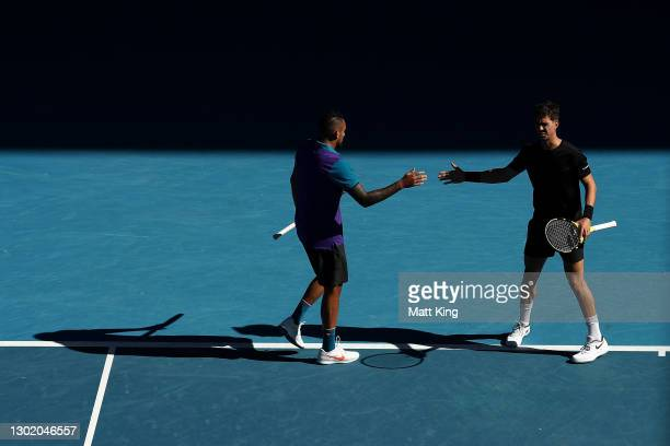 Thanasi Kokkinakis of Australia and Nick Kyrgios of Australia high five in their Men's Doubles second round match against Wesley Koolhof of the...