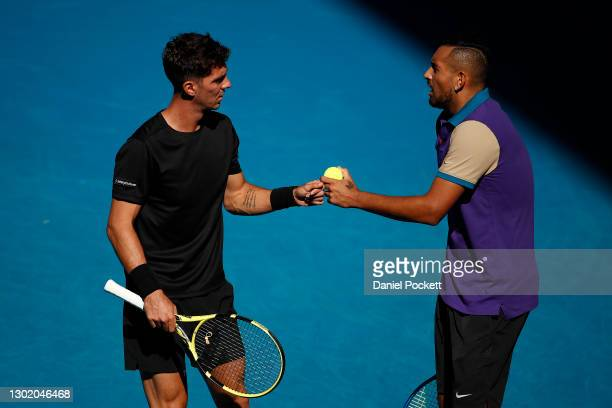 Thanasi Kokkinakis of Australia and Nick Kyrgios of Australia in their Men's Doubles second round match against Wesley Koolhof of the Netherlands and...