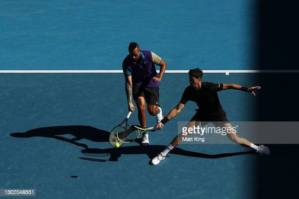 Thanasi Kokkinakis of Australia and Nick Kyrgios of Australia play in their Men's Doubles second round match against Wesley Koolhof of the...