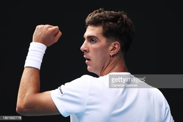 Thanasi Kokkinakis of Australia celebrates after winning a point in his Men's Singles second round match against Stefanos Tsitsipas of Greece during...