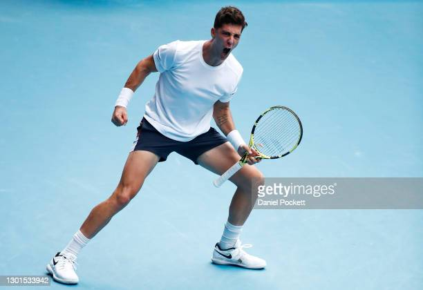 Thanasi Kokkinakis of Australia celebrates after winning the fourth set in his Men's Singles second round match against Stefanos Tsitsipas of Greece...