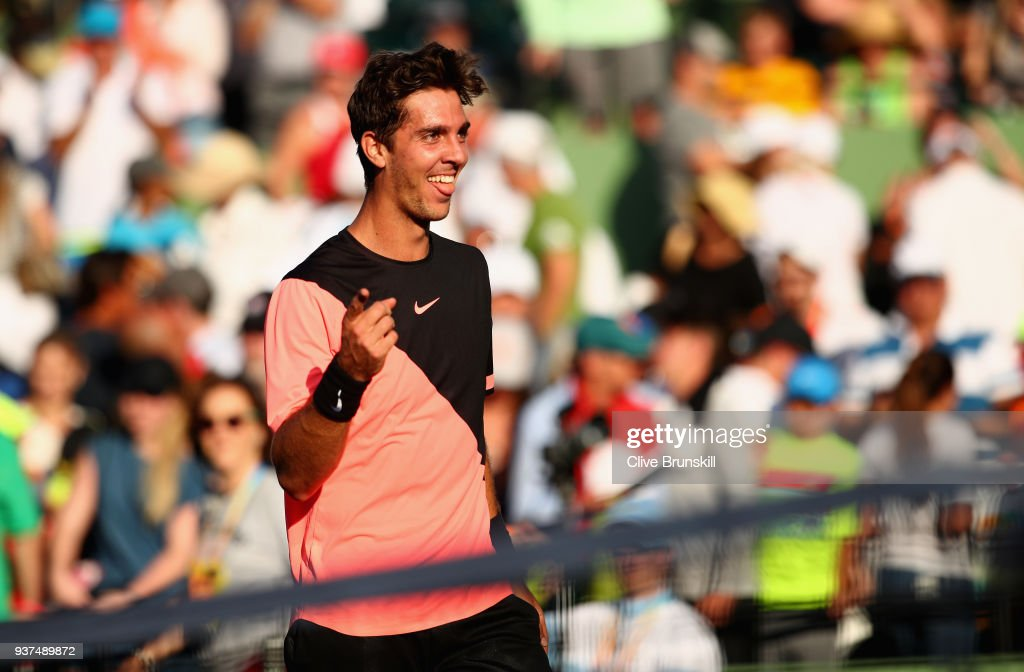 Thanasi Kokkinakis of Australia celebrates at the net after his three set victory against Roger Federer of Switzerland in their second round match during the Miami Open Presented by Itau at Crandon Park Tennis Center on March 24, 2018 in Key Biscayne, Florida.