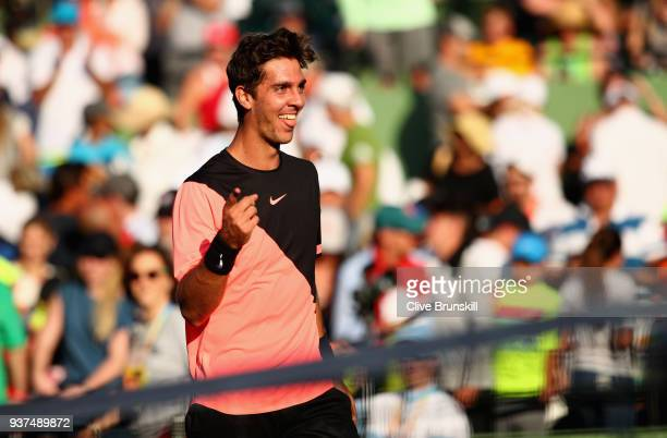 Thanasi Kokkinakis of Australia celebrates at the net after his three set victory against Roger Federer of Switzerland in their second round match...