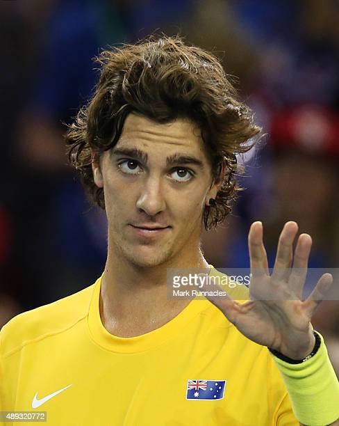 Thanasi Kokkinakis of Australia celebrates his victory over Dan Evens of Great Britain during his singles match on the third day of the Davis Cup...