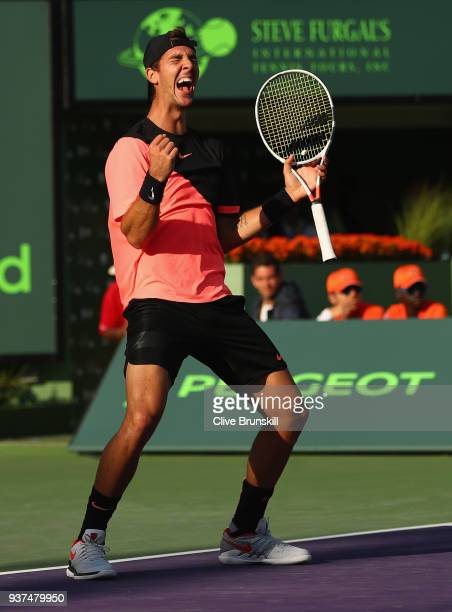 Thanasi Kokkinakis of Australia celebrates match point against Roger Federer of Switzerland in their second round match during the Miami Open...