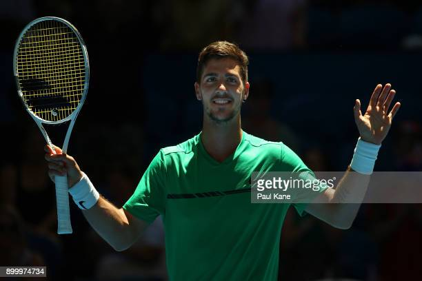 Thanasi Kokkinakis of Australia celebrates winning his singles match against Vasek Pospisil of Canada on day 2 of the 2018 Hopman Cup at Perth Arena...