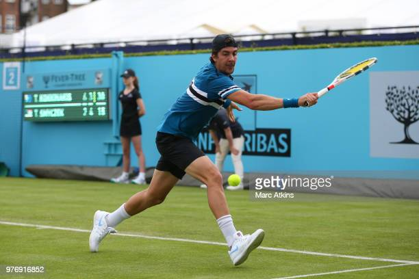 Thanasi Kokkinakis of Australia hits a backhand during his match against Tim Smyczek of USA during qualifying Day 2 of the FeverTree Championships at...