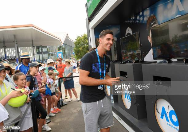 Thanasi Kokkinakis of Australia is seen playing the AO video game in garden square during day six of the 2018 Australian Open at Melbourne Park on...