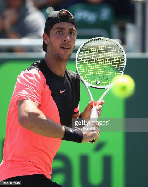 Thanasi Kokkinakis of Australia plays a backhand against Fernando Verdasco of Spain in their third round match during the Miami Open Presented by...
