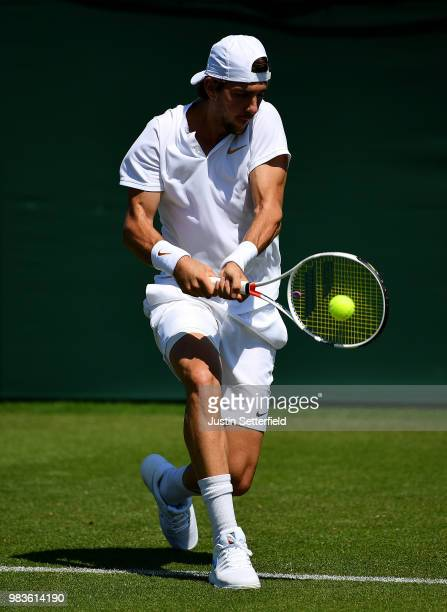 Thanasi Kokkinakis of Australia plays a backhand against Marcelo Arevalo of El Salvador during the Wimbledon Lawn Tennis Championships Qualifying at...