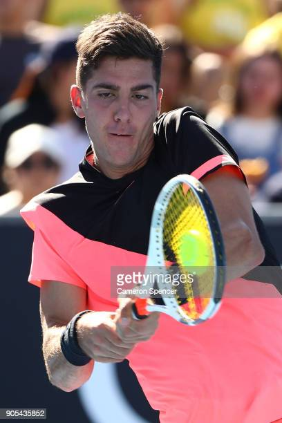 Thanasi Kokkinakis of Australia plays a backhand in his first round match against Daniil Medvedev of Russia on day two of the 2018 Australian Open at...