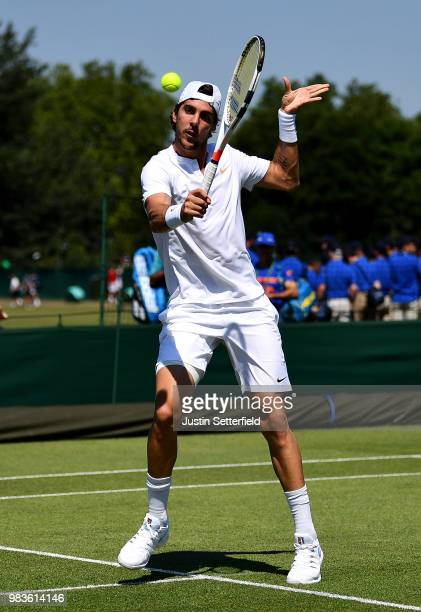 Thanasi Kokkinakis of Australia plays a backhand volley against Marcelo Arevalo of El Salvador during the Wimbledon Lawn Tennis Championships...