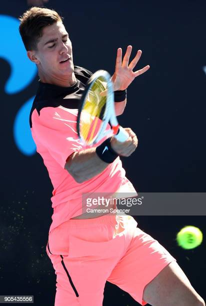 Thanasi Kokkinakis of Australia plays a forehand in his first round match against Daniil Medvedev of Russia on day two of the 2018 Australian Open at...