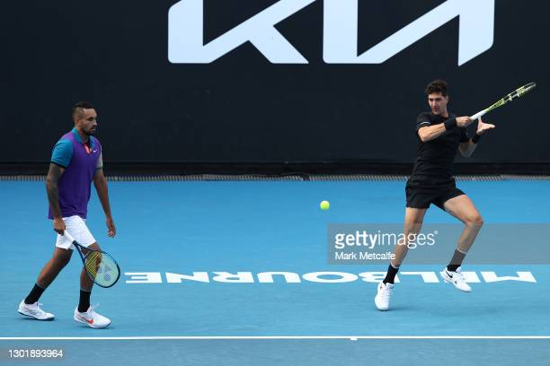 Thanasi Kokkinakis of Australia plays a forehand in his Men's Doubles second round match with partner Nick Kyrgios of Australia against Lloyd Harris...