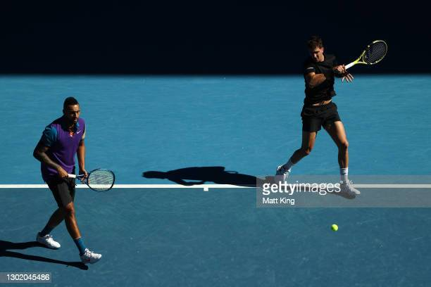 Thanasi Kokkinakis of Australia plays a forehand in his Men's Doubles second round match with partner Nick Kyrgios of Australia against Wesley...