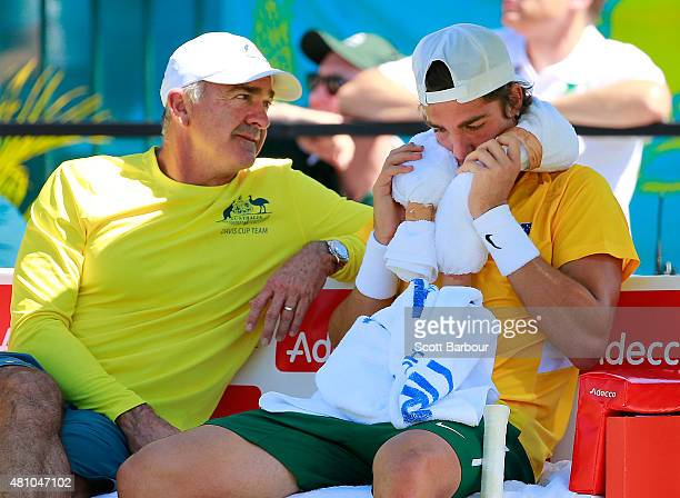 Thanasi Kokkinakis of Australia reacts as Wally Masur captain of Australia speaks to him in between games in his singles match against Mikhail...