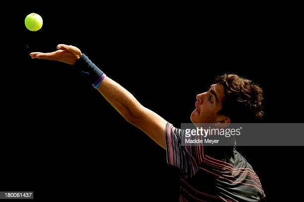 Thanasi Kokkinakis of Australia serves during his junior boys' singles final against Borna Coric of Croatia on Day Fourteen of the 2013 US Open at...