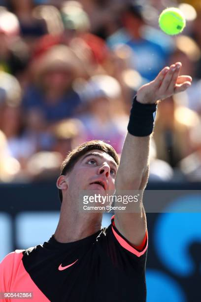 Thanasi Kokkinakis of Australia serves in his first round match against Daniil Medvedev of Russia on day two of the 2018 Australian Open at Melbourne...