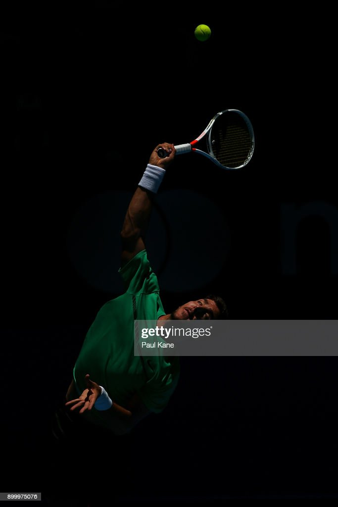 Thanasi Kokkinakis of Australia serves in his singles match against Vasek Pospisil of Canada on day 2 of the 2018 Hopman Cup at Perth Arena on December 31, 2017 in Perth, Australia.