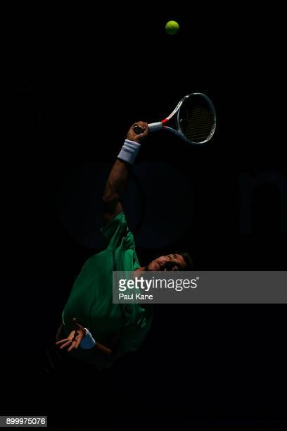 Thanasi Kokkinakis of Australia serves in his singles match against Vasek Pospisil of Canada on day 2 of the 2018 Hopman Cup at Perth Arena on...