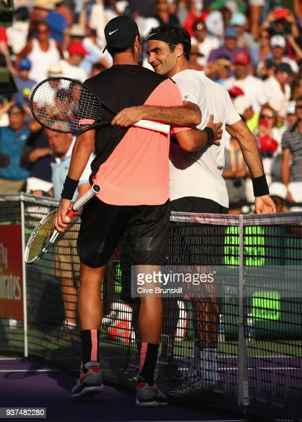 Thanasi Kokkinakis of Australia shakes hands at the net after his three set victory against Roger Federer of Switzerland in their second round match...
