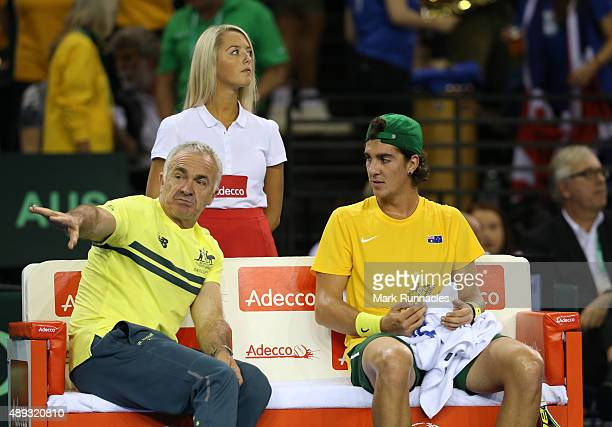 Thanasi Kokkinakis of Australia with Australia captain Wally Masur during his singles match with Dan Evens of Great Britain during his singles match...