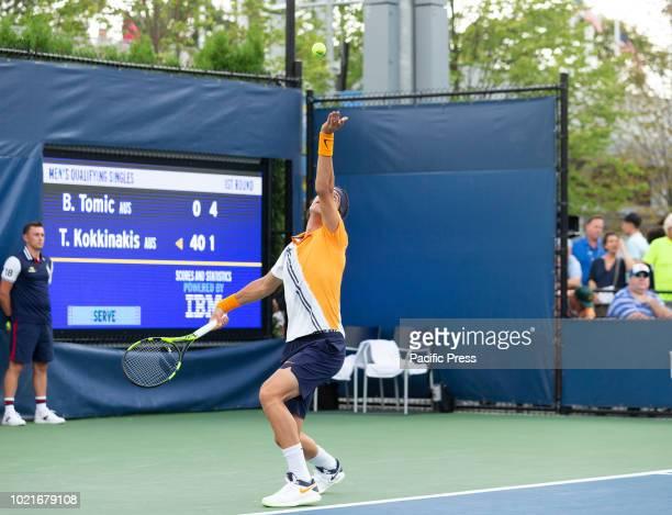 Thanasi Kokkinakis serves during qualifying day 1 against Bernard Tomic of Australia at US Open Tennis championship at USTA Billie Jean King National...