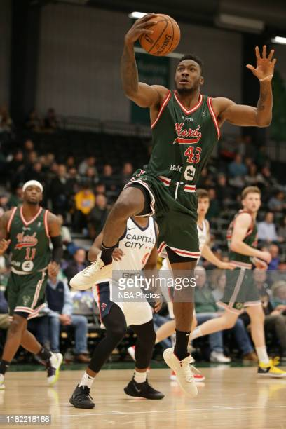 Thanasis Antetokounmpo from the Wisconsin Herd drives through the Capitol City GoGo defense during the first half of a NBA GLeague game on November...