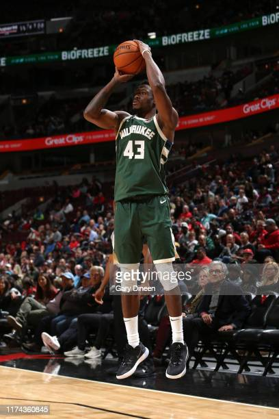 Thanasis Antetokounmpo of Milwaukee Bucks shoots three point basket against the Chicago Bulls on October 7 2019 at the United Center in Chicago...