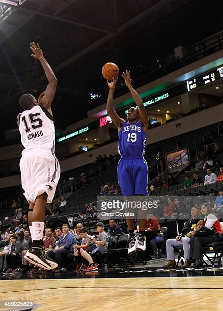 Thanasis Antetokounmpo of the Delaware 87ers shoots over Josh Howard of the Austin Toros on December 20 2013 at the Cedar Park Center in Cedar Park...
