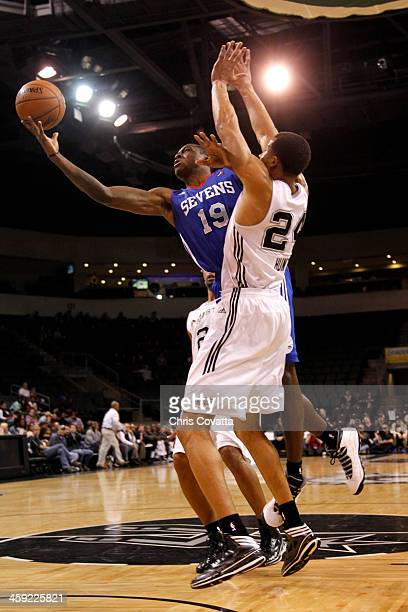 Thanasis Antetokounmpo of the Delaware 87ers shoots over Kyle Hunt of the Austin Toros on December 20 2013 at the Cedar Park Center in Cedar Park...
