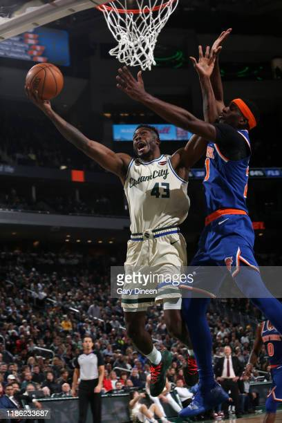 Thanasis Antetokounmpo of the Milwaukee Bucks drives to the basket against the New York Knicks on December 2 2019 at the Fiserv Forum Center in...