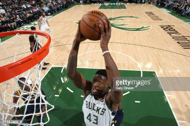 Thanasis Antetokounmpo of the Milwaukee Bucks dunks the ball against the Utah Jazz on October 9 2019 at the Fiserv Forum Center in Milwaukee...