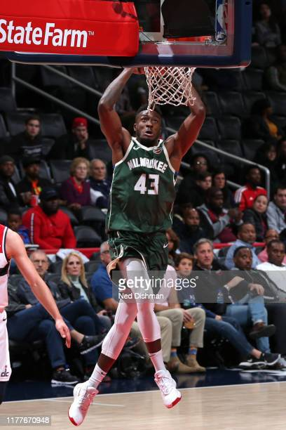 Thanasis Antetokounmpo of the Milwaukee Bucks dunks the ball against the Washington Wizards during a preseason game on October 13 2019 at Capital One...