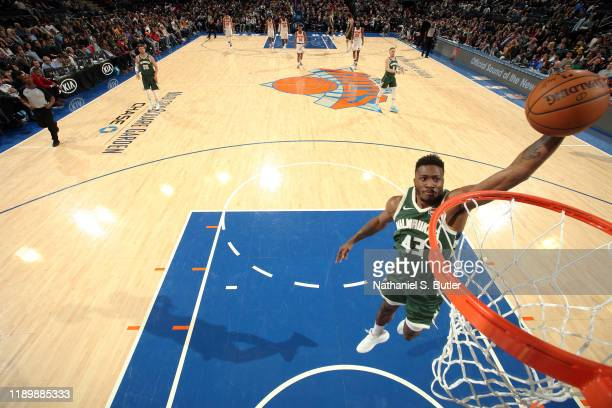 Thanasis Antetokounmpo of the Milwaukee Bucks dunks the ball during the game against the New York Knicks on December 21 2019 at Madison Square Garden...