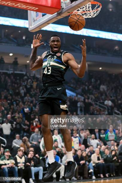 Thanasis Antetokounmpo of the Milwaukee Bucks dunks the ball in the first quarter against the Denver Nuggets at the Fiserv Forum on January 31 2020...