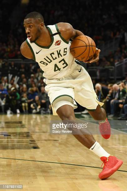 Thanasis Antetokounmpo of the Milwaukee Bucks handles the ball during a game against the San Antonio Spurs at Fiserv Forum on January 04 2020 in...